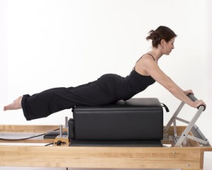 Pilates Woman on Reformer